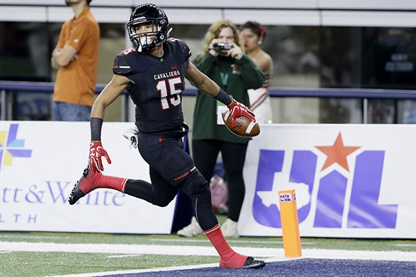Lake Travis running back Maleek Barkley (15) runs into the end zone for a touchdown after catching a pass during the first half of the Class 6A Division I state football championship against the Woodlands in Arlington, Texas, Saturday, Dec. 17, 2016. (AP Photo/LM Otero)