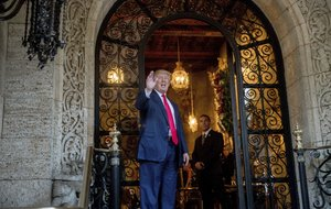President-elect Donald Trump waves to members of the media after a meeting with admirals and generals from the Pentagon at Mar-a-Lago, in Palm Beach, Fla., Wednesday, Dec. 21, 2016.