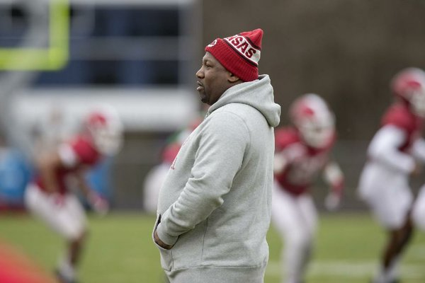 Arkansas director of recruiting E.K. Franks watches during Razorbacks practice on Monday, Dec. 26, 2016, at Charlotte Latin High School.
