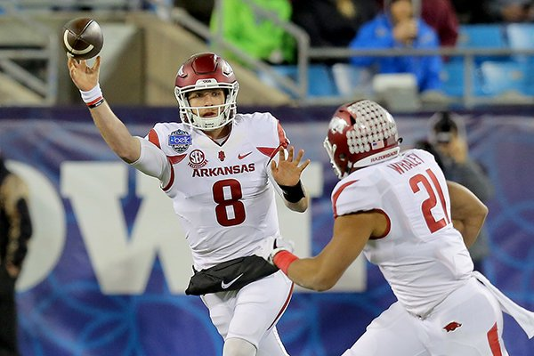 Arkansas quarterback Austin Allen throws a pass during the Belk Bowl against Virginia Tech on Thursday, Dec. 29, 2016, in Charlotte, N.C.