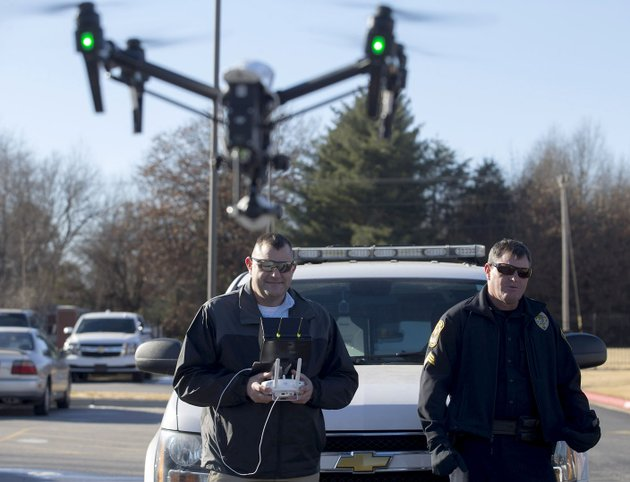 rogers-police-sgt-miles-mason-right-watches-as-capt-jarod-mason-flies-the-departments-dji-inspire-1-v20-quadcopter-on-dec-19-behind-the-rogers-police-department