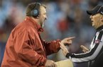 Arkansas head coach Bret Bielema speaks with an official following an inadvertent whistle in the second quarter against Virginia Tech during the Belk Bowl on Thursday, Dec. 29, 2016, at Bank of America Stadium in Charlotte, N.C.