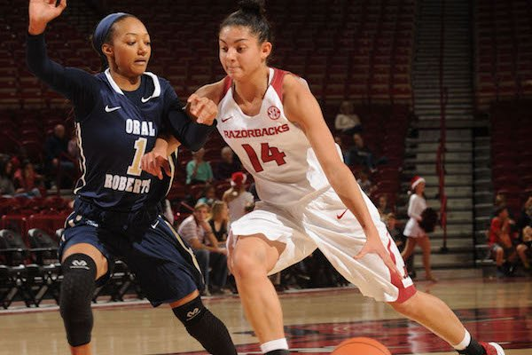 Jailyn Mason (14) of Arkansas drives to the lane as Kaylan Mayberry of Oral Roberts defends Wednesday, Dec. 21, 2016, during the second half of the Razorbacks' 70-60 loss in Bud Walton Arena. Visit nwadg.com/photos to see more photographs from the game.