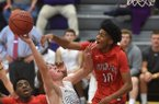 Tyler Roth of Fayetteville High has his shot blocked by Northside defender Isaiah Joe (10) on Tuesday, Nov. 15, 2016, during a game at Fayetteville High School.