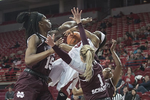 Arkansas' Malica Monk gets her shot blocked by Mississippi State's Teaira McCowen, (from left) Blair Schaefer and Morgan William on Thursday, Jan. 5, 2017, at Bud Walton Arena in Fayetteville.