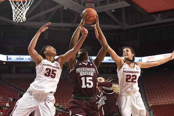 Arkansas' Alecia Cooley (35) and Bailey Zimmerman (22) battle for a rebound against Mississippi State's Teaira McCowan during a game Thursday, Jan. 5, 2017, in Fayetteville.