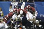 Washington wide receiver John Ross (1) is tackled by Alabama defensive lineman Dalvin Tomlinson (54) and Alabama linebacker Reuben Foster (10) during the first half of the Peach Bowl NCAA college football playoff game, Saturday, Dec. 31, 2016, in Atlanta.