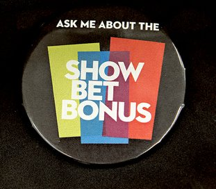 The Sentinel-Record/Richard Rasmussen SHOW BET BONUS: One of the buttons that will be worn by parimutuel clerks during the live race meet, which begins Jan. 13.