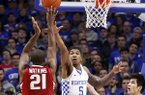 Arkansas' Manuale Watkins (21) shoots while defended by Kentucky's Malik Monk (5) and Derek Willis during the first half of an NCAA college basketball game, Saturday, Jan. 7, 2017, in Lexington, Ky. (AP Photo/James Crisp)