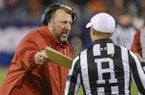 Arkansas head coach Bret Bielema argues a call with officials during the second half of the Belk Bowl NCAA college football game against Virginia Tech in Charlotte, N.C., Thursday, Dec. 29, 2016. Virginia Tech won 35-24. (AP Photo/Bob Leverone)