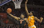 Florida guard KeVaughn Allen (5) shoots a layup past Tennessee forward Kyle Alexander (11) during the first half of an NCAA college basketball game in Gainesville, Fla., Saturday, Jan. 7, 2017.