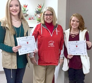 Submitted photo Mountain Pine High School Principal Denise Taylor, center, recently congratulated Caitlyn Beckwith, left, and Audrey Dailey, who were selected as two of the school's recipients of the Outstanding Student Awards for December.
