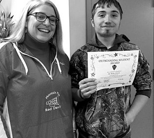 Submitted photo Mountain Pine High School student Ricky Clinton, right, was recently congratulated by Principal Denise Taylor for receiving one of the school's Outstanding Student Awards for December.