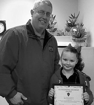 Submitted photo Mountain Pine Elementary School Principal Toby Crosby, left, recently congratulated Nevaeh Poteete for receiving the school's Outstanding Student Award for December.