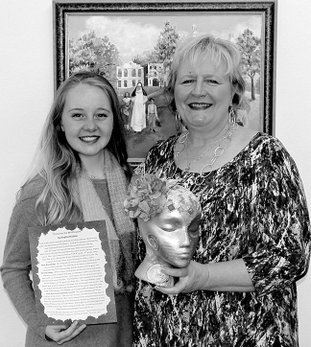 Submitted photo St. John's Catholic School alum Sophie Rudder, left, chose to dedicate her Debutante Creation of Hope to Principal Angela Isaacs, who was her elementary teacher.