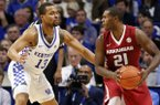 Arkansas' Manuale Watkins (21) looks for an opening on Kentucky's Isaiah Briscoe (13) during the second half of an NCAA college basketball game, Saturday, Jan. 7, 2017, in Lexington, Ky. (AP Photo/James Crisp)
