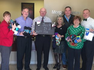 The Morgan Stanley office collected socks for the Ouachita Children's Center and for The CALL, Children of Arkansas are Loved for a Lifetime. From left are Denise Franks, Brad Hudgens, Robert Walker, Debby Butler, Brad Jolly, Susan Goltz Siegel and Dennis Berry. Not pictured are Tina Smoot-Donoho, Mike Adamkiewicz, John Adamkiewicz and Landon Trusty. Morgan Stanley Wealth Management is located at 4262 Central Ave. Suite A. For information, call 501-622-3209. Submitted photo