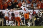 Clemson's Deshaun Watson celebrates a last second touchdown pass to Hunter Renfrow during the second half of the NCAA college football playoff championship game against Alabama Tuesday, Jan. 10, 2017, in Tampa, Fla. (AP Photo/John Bazemore)