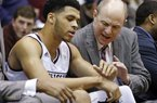 Mississippi State head coach Ben Howland, left, encourages guard Quinndary Weatherspoon to ice down his injured wrist in the second half of an NCAA college basketball game in Jackson, Miss., Monday, Dec. 19, 2016. Mississippi State won 86-44. (AP Photo/Rogelio V. Solis)