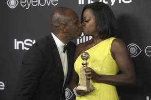 "Viola Davis, right, winner of the award for best performance by an actress in a supporting role in a motion picture for ""Fences,"" kisses Julius Tennon as they arrive at the InStyle and Warner Bros. Golden Globes afterparty at the Beverly Hilton Hotel on Sunday, in Beverly Hills, Calif."