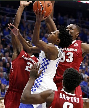 The Associated Press CROWDING FOX: Arkansas' Adrio Bailey (2), Moses Kingsley (33) and Jaylen Barford (0) join forces against Kentucky's De'Aaron Fox, center, in Saturday's matchup in Lexington, Ky. Arkansas' Trey Thompson, who has been the backup for Kingsley most of the season, will take the floor with Kingsley tonight against Mississippi State.