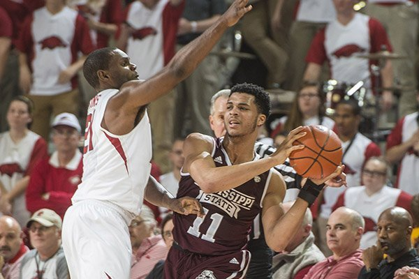 Mississippi State's Quinndary Weatherspoon is guarded by Arkansas' Manny Watkins during a game Tuesday, Jan. 10, 2017, in Fayetteville.
