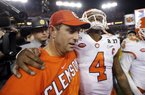 Clemson Coach Dabo Swinney embraces quarterback Deshaun Watson after the Tigers defeated Alabama for the national championship Monday night at Raymond James Stadium in Tampa, Fla. Watson passed for 420 yards and three touchdowns, and rushed for another score as the Tigers won their second national title and first since 1981.