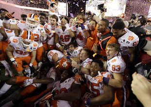 The Associated Press NATIONAL CHAMPIONS: Clemson players celebrate after a 35-31 win over Alabama in the NCAA college football playoff championship game Monday night in Tampa, Fla.