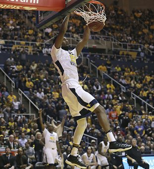 The Associated Press BEARS DOWN: West Virginia forward Brandon Watkins (20) dunks the ball on a fast break during the second half of an NCAA college basketball game against Baylor Tuesday night in Morgantown, W.Va. The Mountaineers won 89-68.