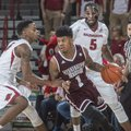 Mississippi State's Lamar Peters surveys the floor while being guarded by Arkansas' Daryl Macon in t...