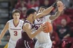 Arkansas' Anton Beard (31) guards Mississippi State's Quinndary Weatherspoon (11) during a game Tuesday, Jan. 10, 2017, in Fayetteville.