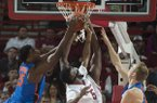 Arkansas and Florida players battle for a rebound during a game Thursday, Dec. 29, 2016, in Fayetteville.