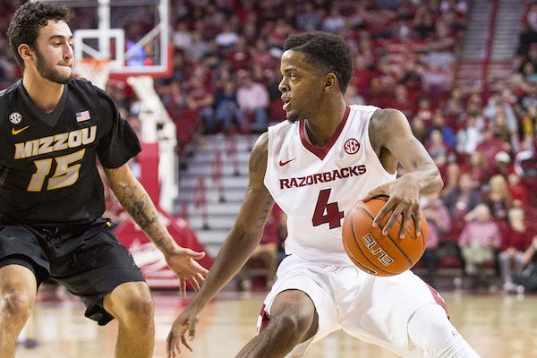 Daryl Macon (4) of Arkansas bring the ball down the court as Jordan Geist (15) defends from Missouri at Bud Walton Arena, Fayetteville, AR, Saturday, January 14, 2017.