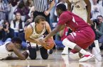 Texas A&M forward D.J. Hogg (1) attempts to hold on to a fumbled pass while Arkansas forward Arlando Cook (5) defends during an NCAA college basketball game Tuesday, Jan. 17, 2017 at Reed Arena in College Station, Texas. (Timothy Hurst/College Station Eagle via AP)