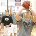 Austin Morris warms up Jan. 3 before a game against Haas Hall. Morris missed several games because o...