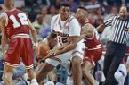 Alabama's Robert Horry, right reaches in on Arkansas' Oliver Miller (25) during first half action in the NCAA Southeast Regional on Thursday, March 21, 1991 at the Charlotte Coliseum in Charlotte, N.C. (AP Photo/Lynne Sladky)