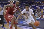 LSU guard Antonio Blakeney (2) drives past Alabama forward Jimmie Taylor (10) in the second half of an NCAA college basketball game, Saturday, Jan. 14, 2017, in Baton Rouge, La. (Hilary Scheinuk/The Baton Rouge Advocate via AP)