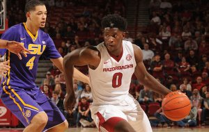 Jaylen Barford (0) of Arkansas drives around Skylar Mays of LSU Saturday, Jan. 21, 2017, during the second half of play in Bud Walton Arena. Visit nwadg.com/photos to see more photographs from the game.