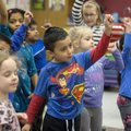 Alan Linares and classmates dance Friday to a song in their kindergarten class at Reagan Elementary ...