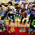 Santiago Machado Cameringo (left) and Kingston Lewis (right) dance Friday to the nursery rhyme I'm a...