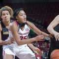 Arkansas senior Alecia Cooley loses control of the ball while being defended by Missouri junior Bir ...