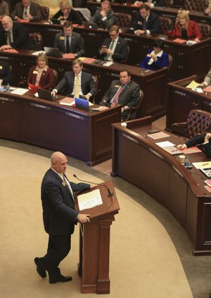 Rep. Mathew Pitsch speaks Monday on the House floor as he presents the governor's tax-cut bill.