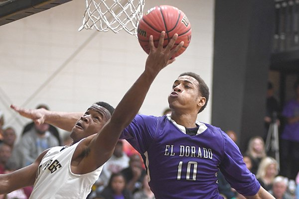 El Dorado center Daniel Gafford (10) defends a shot from Hot Springs' Taryvun Gordon (2) during a game Friday, Dec. 16, 2016, in Hot Springs.
