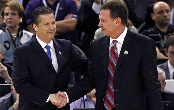 Kentucky head coach John Calipari, left, greets Kansas head coach Bill Self before the NCAA Final Four tournament college basketball championship game Monday, April 2, 2012, in New Orleans. (AP Photo/Bill Haber)