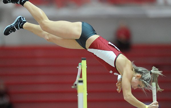 Tori Weeks of Arkansas clears the bar Friday, Jan. 27, 2017, during the pole vault competition in the Razorback Invitational in the Randal Tyson Track Center in Fayetteville.