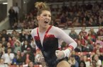 Braie Speed of Arkansas reacts to her performance on the bars against Missouri Friday, Jan. 13, 2017 at Barnhill Arena in Fayetteville.