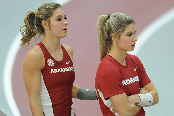 Lexi Weeks (left) and Tori Weeks of Arkansas speak Friday, Jan. 27, 2017, during the pole vault competition in the Razorback Invitational in the Randal Tyson Track Center in Fayetteville.