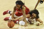 Arkansas forward Kiara Williams (10) and Georgia's Pachis Roberts (11) fight for a loose ball Thursday, Feb. 2, 2017, during their game at Bud Walton Arena in Fayetteville.