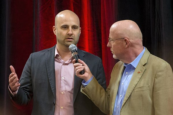 Chuck Barrett (right) talks with Arkansas assistant coach Barry Lunney on Thursday, Feb. 2, 2017, on the team's signing day results during the Northwest Arkansas Razorback Club Signing on the Hill event at the Holiday Inn & Convention Center in Springdale.