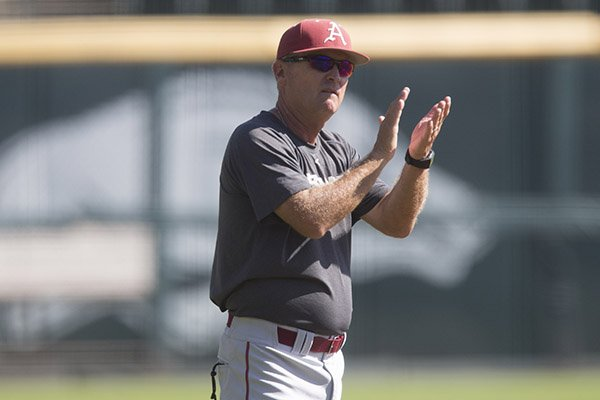 Arkansas coach Dave Van Horn encourages players during a practice Monday, Oct. 17, 2016, at Baum Stadium in Fayetteville.